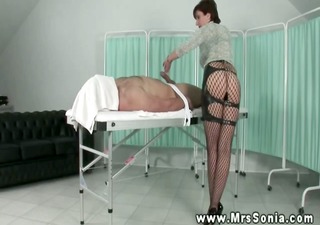 dominatrix-bitch lends him a hand with his hard