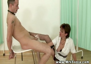 dominate nurse gives her patient a hand with his